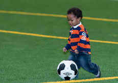 Child in Recplex playing soccer