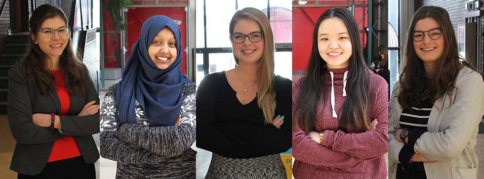 Five UWinnipeg economic students standing with arms crossed