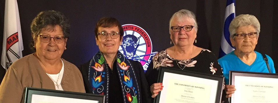 three Metis honorary doctorates posing with Dr. Annette Trimbee